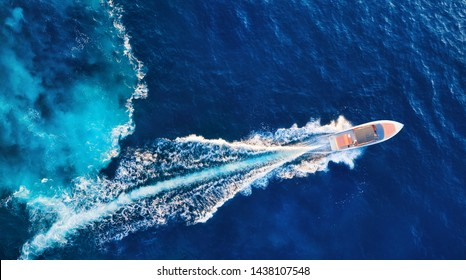 Croatia. Yachts at the sea surface. Aerial view of luxury floating boat on blue Adriatic sea at sunny day. Travel - image - Shutterstock ID 1438107548
