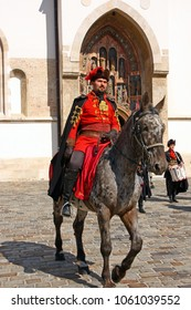 CROATIA ZAGREB, 1 OCTOBER 2017: Changing of the guard. Horseman member of the Cravat Regiment in front of the Church of St. Mark, Zagreb