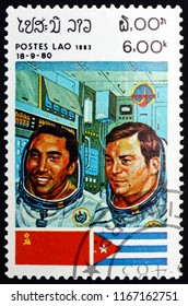 CROATIA ZAGREB, 19 MAY 2018: a stamp printed in Laos shows Cosmonauts and Flags of USSR and Cuba, Intercosmos Space Cooperation Program, circa 1983