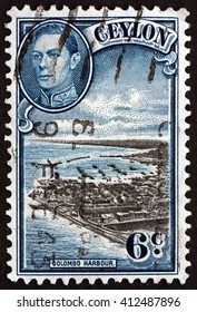 CROATIA ZAGREB, 28 MARCH 2016: a stamp printed in Sri Lanka shows View of Colombo Harbour and Portrait of King George VI, circa 1938