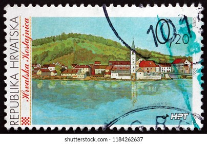CROATIA ZAGREB, 29 JUNE 2018: a stamp printed in Croatia shows view of Hrvatska Kostajnica, liberated town, circa 1995