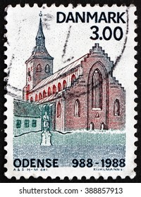 CROATIA ZAGREB, 7 FEBRUARY 2016: a stamp printed in Denmark shows St. Cnut's Church and Statue of Hans Christian Andersen, Odense, 1000th Anniversary, circa 1988