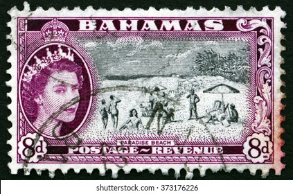 CROATIA ZAGREB, 9 OCTOBER 2015: a stamp printed in Bahamas shows Paradise Beach, and Queen Elizabeth II, circa 1954