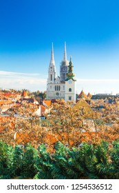 Croatian capital Zagreb, city skyline, catholic cathedral and red roofs in city center, view from Upper town. Christmas advent decoration.
