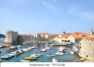 The Croatian city of Dubrovnik coastal area, a promenade with yachts at the fortress , the blue water, the walls of the castle