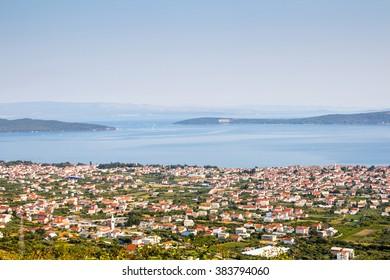 Croatian coastal town, windy sea, bollard and life buoy on a dock