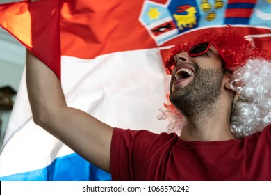 Croatian fan celebrating with flag