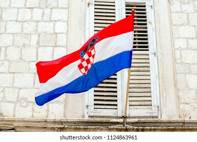 Croatian flag hanging on the background of an old building