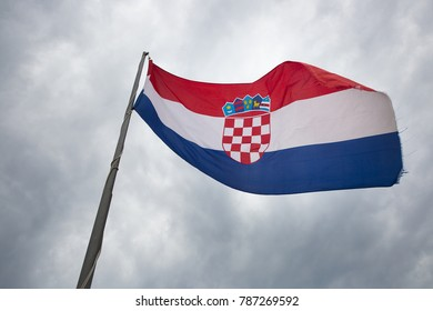 Croatian flag loating with a cloudy sky background