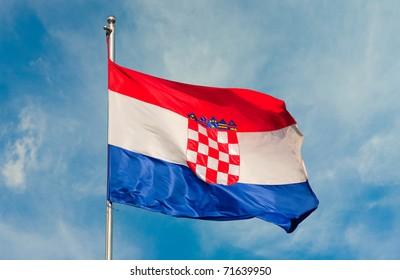 croatian flag on a pole over beautiful sky