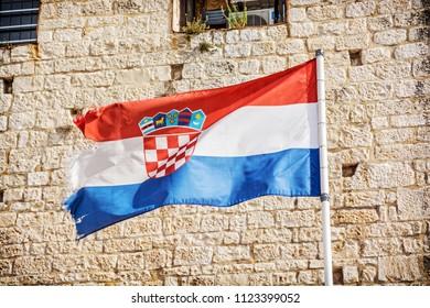 Croatian flag on stone background. Symbolic object.