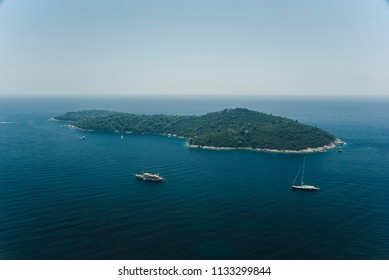 Croatian island/green island in the Adriatic sea close to the Croatian coast surrounded by beaches and sailing boats.