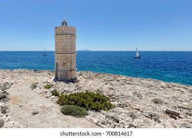 Croatian lighthouse beside the sea