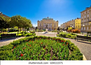 Croatian national theater in Rijeka square view, fountain and architecture, Kvarner bay, Croatia