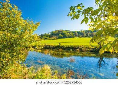 Croatian nature, countryside landscape, river Dobra in autumn and old fortress in Novigrad, Karlovac county, Croatia