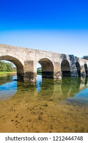 Croatian river Dobra, beautiful old stone bridge in village of Novigrad, Karlovac county, countryside landscpae
