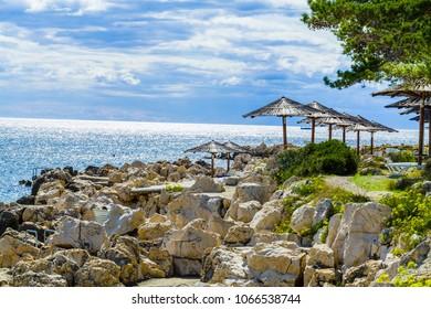 Croatian seaside restaurant terrace with deliscious seafood at rab island.
