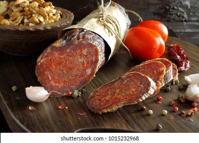 Croatian spicy sausage on wooden board. Kulen.