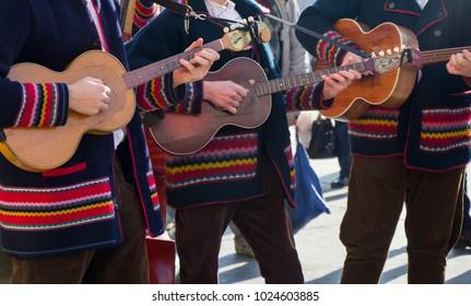 Croatian tamburitza musicians in traditional Croatian folk costumes