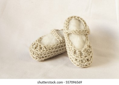 Crochet baby booties isolated on white, Hand-made baby booties