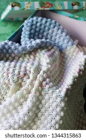 crochet blanket in pastel colors in a box,  a gift for a birt