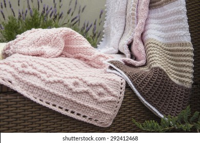 Crochet, Cable Knit Baby Blankets on Sofa with Lavender, Closeup High Contrast