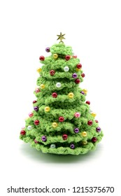 crochet Christmas tree with pearls on white isolated background.