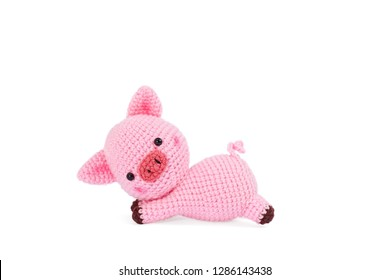 Crochet doll. Amigurumi or Crochet doll of a cute pig isolated on white background