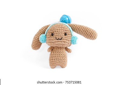 Crochet doll. Amigurumi or Crochet doll of a cute rabbit with blue headphone isolated on a white background