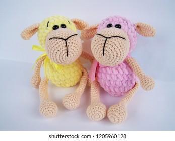Crochet doll. A handmade crochet doll of a little lamb in pink