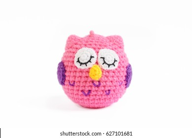 crochet doll of a pink owl, isolated on white background
