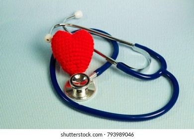Crochet red heart form and stethoscope, healthy and healthcare concept idea.