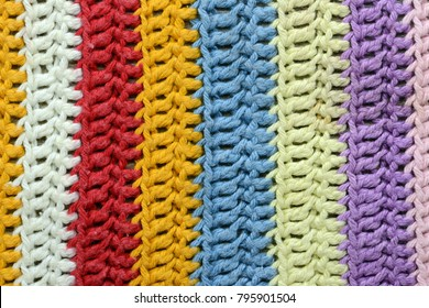 Crochet texture of handmade oven cloth with stipes.