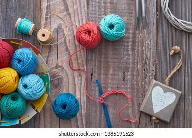Crochet, top view on yarn balls on rustic wood, flat lay