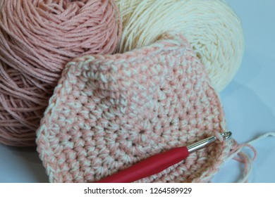 Crochet wool and red hook.