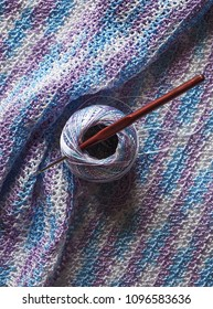 Crocheted fabric made of multi-colored microfiber. Melange thread