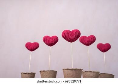 Crocheted hearts on wooden sticks