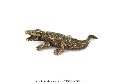 crocodile alligator Vintage Antique grunge bronze brass figurine statue of beautiful animal, isolated on white background. Decoration Sculpture for interior. Copy Space. Close up Selective soft focus.