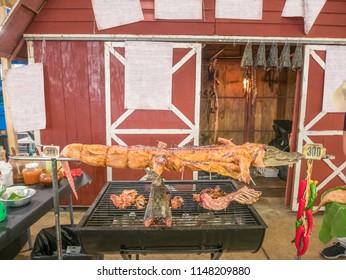 Crocodile roast on charcoal stove