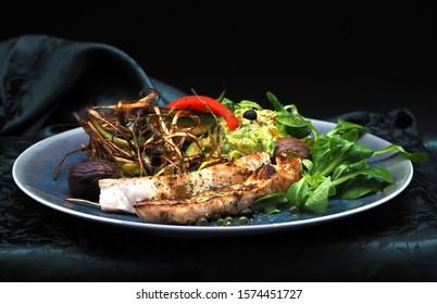 crocodile steak with garnish as decoration