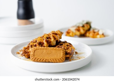 Croffle with biscuit or biscoff on white background.