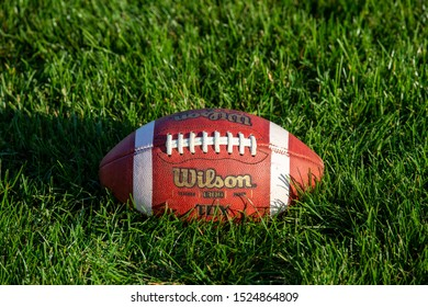 Crofton Nebraska, United States of America, 10-07-2019 Wilson Game Day Football on Green Grass Football Field