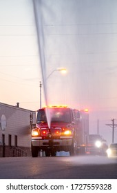 Crofton Nebraska USA May 09, 2020 Fire Truck with Lights On and Water Display at Evening