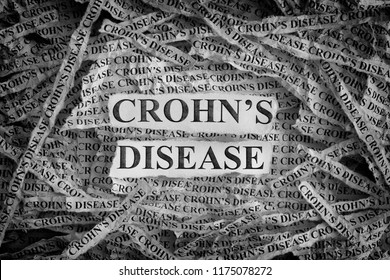 Crohn's Disease. Torn pieces of paper with the words Crohn's Disease. Concept Image. Black and White. Closeup.