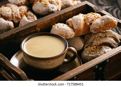 Croissant with almond filling and cup of coffee.