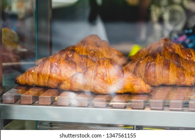 Croissant and bekery on shelf in the coffee shop.