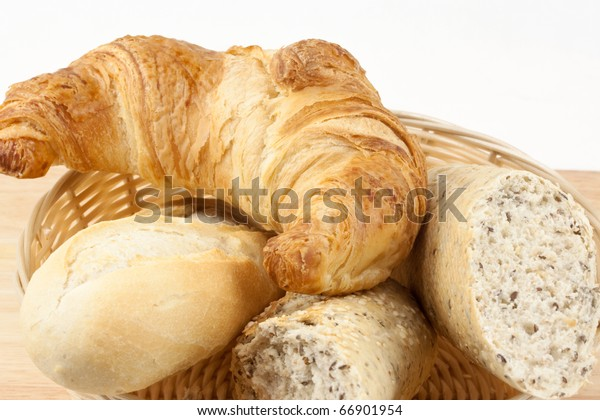 Croissant with bread rolls in basket