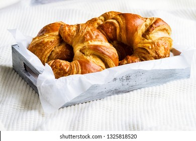 Croissant for breakfast on woolen surface