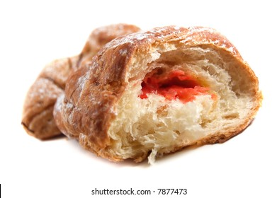 Croissant by a breakfast on a white background