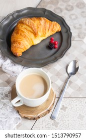 croissant and cappuccino for breakfast